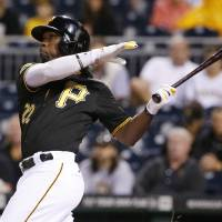 Photo - Pittsburgh Pirates' Andrew McCutchen (22) hits a two-run home run off Chicago Cubs starting pitcher Jason Hammel during the first inning of a baseball game in Pittsburgh Wednesday, June 11, 2014. (AP Photo/Gene J. Puskar)
