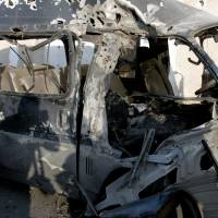 Photo -   This photo released by the Syrian official news agency SANA, shows a damaged vehicle at the scene after an attack in Damascus, Syria, Wednesday, Nov. 7, 2012. (AP Photo/SANA)