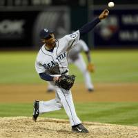 Photo - Seattle Mariners pitcher Roenis Elias delivers a pitch during the third inning of a baseball game against the Oakland Athletics, Thursday, April 3, 2014, in Oakland, Calif. (AP Photo/Beck Diefenbach)