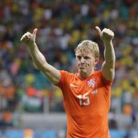 Photo - Netherlands' Dirk Kuyt gives supporters the thumbs up after the Netherlands defeated Costa Rica 4-3 in a penalty shootout after a 0-0 tie during the World Cup quarterfinal soccer match at the Arena Fonte Nova in Salvador, Brazil, Saturday, July 5, 2014. (AP Photo/Wong Maye-E)