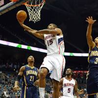 Photo - Atlanta Hawks power forward Al Horford (15) shoots past Indiana Pacers power forward David West (21) during the first half of a preseason NBA basketball game on Tuesday, Oct. 22, 2013, in Atlanta.  (AP Photo/Atlanta Journal-Constitution, Curtis Compton)  MARIETTA DAILY OUT; GWINNETT DAILY POST OUT; LOCAL TV OUT; WXIA-TV OUT; WGCL-TV OUT