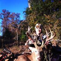 Photo - Linet Navarro with her non-typical buck she killed on Nov. 8, scored at 175 2/8. PHOTO PROVIDED