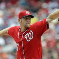 Photo - Washington Nationals pitcher Stephen Strasburg delivers during the first inning of a baseball game against the San Francisco Giants, Sunday, Aug. 24, 2014, in Washington. (AP Photo/Luis M. Alvarez)