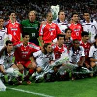 Photo - FILE - In this Sunday, June 21, 1998 file photo, US and Iranian team players pose for a group photo, before the start of their World Cup first round soccer match, at Gerland Stadium, in Lyon, France. On this day: US and Iran seek to keep lid on differences. The World Cup often throws up geopolitical clashes. (AP Photo/Michel Euler, File)