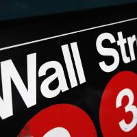Photo - FILE - This Jan. 4, 2010 file photo shows an entrance to a Wall Street subway station in New York. U.S. stocks are opening higher Monday, Aug. 11, 2014, as tensions ease in Ukraine.  (AP Photo/Mark Lennihan, File)