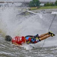 Photo -  Michael Roeder hits the water as he goes down on his wake skate run during the first day of the Air Nautique WWA National Championships on Wednesday, July 8, 2009, on the Oklahoma River in Oklahoma City, Okla.  Photo by Chris Landsberger, The Oklahoman  ORG XMIT: KOD