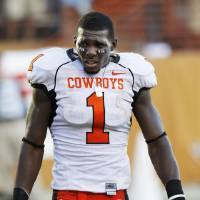 Photo - COLLEGE FOOTBALL: Dez Bryant leaves the field after the loss as Oklahoma State University (OSU) plays the University of Texas (UT) at Darrell K. Royal-Texas Memorial Stadium at Joe Jamail Field in Austin, Texas on Saturday October 25, 2008. By Doug Hoke, The Oklahoman  ORG XMIT: KOD
