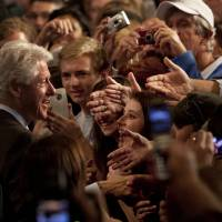 Photo -   Former U.S. President Bill Clinton greets supporters at the Harborside Convention Center Friday, Nov. 2, 2012 in Fort Myers, Fla. (AP Photo/The News-Press, Andrew West) MAGS OUT; NAPLES OUT; NO SALES