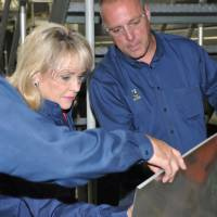 Photo - Gov. Mary Fallin receives a demonstration at Quad/Graphics in Oklahoma City. Photo provided