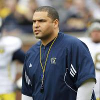Photo - New defensive line coach Jerry Montgomery played at Iowa.  PHOTO COURTESY UNIVERSITY OF MICHIGAN ATHLETICS