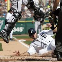 Photo -   Detroit Tigers' Alex Avila, right, slides under Chicago White Sox catcher A.J. Pierzynski to score from second base on a single by Andy Dirks in the second inning of a baseball game, Saturday, May 5, 2012, in Detroit. (AP Photo/Duane Burleson)