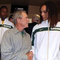 Photo - Former President George W. Bush meets with Baylor center Brittney Griner, right, before their second-round game against Florida State in the NCAA women's college basketball tournament, Tuesday, March 26, 2013, in Waco, Texas. (AP Photo/Robert Rogers, Pool)