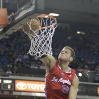 Photo - Los Angeles Clippers forward Blake Griffin dunks on a break away during the first quarter of an NBA basketball game against the Sacramento Kings in Sacramento, Calif., Tuesday, March 19, 2013.(AP Photo/Rich Pedroncelli) ORG XMIT: SCA101
