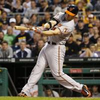 Photo - Baltimore Orioles' Chris Davis hits a two-run home run off Pittsburgh Pirates starting pitcher Francisco Liriano during the fifth inning of a baseball game in Pittsburgh on Tuesday, May 20, 2014. (AP Photo/Gene J. Puskar)