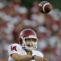 Photo - OU's Sam Bradford throws in the second half during the college football game between the University of Oklahoma and Texas A&M University at Kyle Field in College Station, Texas, Saturday, November 8, 2008.  BY BRYAN TERRY, THE OKLAHOMAN   ORG XMIT: KOD