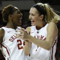 Photo - Oklahoma Sooner's Nicole Kornet (1) and Sharane Campbell (24) celebrate Gioya Carter's basket and being awarded a foul shot in the second half as the University of Oklahoma Sooners (OU) defeat the Kansas Jayhawks 64-61 in NCAA, women's college basketball at The Lloyd Noble Center on Saturday, Feb. 22, 2014  in Norman, Okla. Photo by Steve Sisney, The Oklahoman
