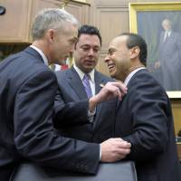 Photo - FILE- In this Feb. 5, 2013, file photo House Judiciary Committee member Rep. Jason Chaffetz, R-Utah, center, Rep. Luis Gutierrez, D-Ill., right, and Rep. Trey Gowdy, R-S.C., share a laugh prior to their committee hearing on immigration reform on Capitol Hill in Washington. The question central to immigration legislation is whether the 11 million immigrants already in the US illegally should get a path to citizenship. The answer from a small but growing number of House Republicans is