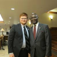 Photo - Mikael Bryant, left, an Oklahoma City University law student and Muslim Youth Leadership Symposium participant, poses for a picture with state Rep. George Young, D-Oklahoma City, after the legislator's presentation at the symposium. [Photo by Carla Hinton, The Oklahoman]
