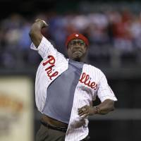 Photo - FILE - In this Oct. 17, 2010 file photo, Gary Matthews throws out the ceremonial first pitch before Game 2 of baseball's National League Championship Series between the Philadelphia Phillies and the San Francisco Giants, in Philadelphia. Longtime Phillies broadcaster Chris Wheeler is out after nearly four decades in the booth and Gary Matthews isn't returning as color analyst, several people familiar with the situation told The Associated Press on Wednesday, Jan. 8, 2014. (AP Photo/Matt Slocum, File)