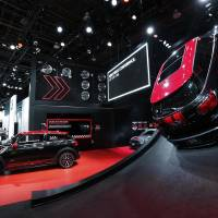 Photo - The Mini exhibit appears Monday on display at media previews for the North American International Auto Show in Detroit.  AP Photo  Paul Sancya