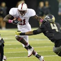 Photo -   Stanford receiver Jamal-Rashad Patterson, left, tries to elude Oregon defender Erick Dargan during the first half of their NCAA college football game in Eugene, Ore., Saturday, Nov. 17, 2012.(AP Photo/Don Ryan)