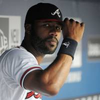 Photo - Atlanta Braves right fielder Jason Heyward tips his cap in the dugout during the first inning of a baseball game against the Cleveland Indians at Turner Field Tuesday, Aug. 27, 2013, in Atlanta. Heyward, whose jaw was by a fastball from New York Mets pitcher Jonathan Neise last weekend, is out 4-6 weeks. (AP Photo/David Tulis)