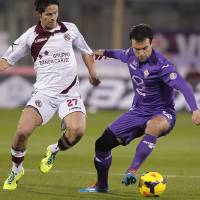 Photo - Fiorentina's Giuseppe Rossi, right, fights for the ball with Livorno's Marco Biagianti during a Serie A soccer match at the Artemio Franchi stadium in Florence, Italy Sunday  Jan. 5, 2014. (AP Photo/Fabrizio Giovannozzi)