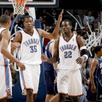 Photo - CELEBRATION: Oklahoma City's Russell Westbrook, left, Kevin Durant, and Jeff Green celebrate during their win in the NBA basketball game between the Oklahoma City Thunder and the Utah Jazz at the Ford Center in Oklahoma City, Wednesday, Jan. 14, 2009.  PHOTO BY BRYAN TERRY, THE OKLAHOMAN ORG XMIT: KOD