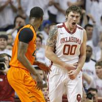 Photo - OU's Ryan Spangler (00) reacts after a basket near Kamari Murphy (21) in the first half during the NCAA men's Bedlam basketball game between the Oklahoma State Cowboys (OSU) and the Oklahoma Sooners (OU) at Lloyd Noble Center in Norman, Okla., Monday, Jan. 27, 2014. Photo by Nate Billings, The Oklahoman