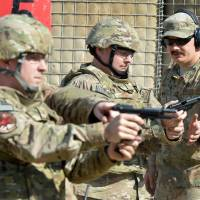 Photo - Air Force Tech Sgt. Steven Ely He trains airmen on how to react in case of insider attacks.