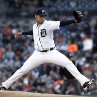 Photo - Detroit Tigers pitcher Anibal Sanchez throws against the Atlanta Braves in the first inning of a baseball game in Detroit, Friday April 26, 2013.  (AP Photo/Paul Sancya)