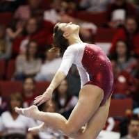 Photo - OU's Sara Stone competes on the beam during the Beauty and the Beast event at the Lloyd Noble Center in Norman, Okla., where the University of Oklahoma wrestling team competed against Virginia Tech and the OU women's gymnastics team competed against North Carolina State, Friday, Jan. 27, 2012. Photo by Nate Billings, The Oklahoman