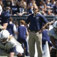 Photo - In this April 12, 2014, photo, Penn State coach James Franklin watches the NCAA college football team's annual Blue-White spring scrimmagein State College, Pa. Franklin is trying to inject Penn State with the enthusiasm he brought to Vanderbilt. (AP Photo/Keith Srakocic)