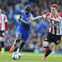 Photo - Chelsea's Ramires, left, tries to dribble past Sunderland's Jack Colback, right, during their English Premier League soccer match at the Stamford Bridge ground in London, Saturday, April 19, 2014. (AP Photo/Lefteris Pitarakis)