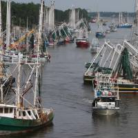 Photo -   Boats seeking safe harbor from Tropical Storm Isaac fill the Industrial Canal in Gulfport, Miss., on Monday Aug. 27, 2012. (AP Photo/Sun Herald, John Fitzhugh)