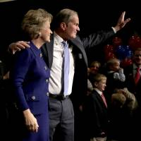 Photo -   U.S. Senate candidate, Rep. Todd Akin, R-Mo., and his wife Lulli wave to supporters after Akin gave his concession speech to U.S. Sen. Claire McCaskill, D-Mo. Tuesday, Nov. 6, 2012, in Chesterfield, Mo. (AP Photo/Charlie Riedel)