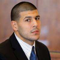 Photo - FILE - In this Oct. 9, 2013 file photo, former New England Patriots NFL football player Aaron Hernandez attends a pretrial court hearing in Fall River, Mass. Hernandez is due in court Wednesday, May 28, 2014 to be arraigned on murder charges for allegedly ambushing and gunning down two men in 2012 after a chance encounter inside a Boston nightclub. (AP Photo/Brian Snyder, Pool, File)