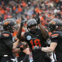 Photo - COLLEGE FOOTBALL / BOWL GAME / CELEBRATION: Oklahoma State's Clint Chelf (10), Blake Jackson (18) and Austin Hays (84) celebrate a Jackson touchdown during the Heart of Dallas Bowl football game between Oklahoma State University (OSU) and Purdue University at the Cotton Bowl in Dallas,  Tuesday,Jan. 1, 2013. Photo by Sarah Phipps, The Oklahoman