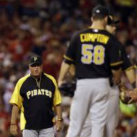 Photo - Pittsburgh Pirates manager Clint Hurdle, left, walks out to the mound to remove starting pitcher Brandon Cumpton (58) from a baseball game during the fourth inning against the St. Louis Cardinals Wednesday, July 9, 2014, in St. Louis. (AP Photo/Jeff Roberson)