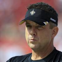 Photo -   FILE - This Oct. 16, 2011 file photo shows New Orleans Saints head coach Sean Payton watching his team warm up for an NFL game against the Tampa Bay Buccaneers, in Tampa, Fla. NFL Commissioner Roger Goodell has rejected the appeals of coach Sean Payton and other New Orleans Saints officials stemming from the league's probe into the club's bounty system. After hearing from Payton, general manager Mickey Loomis and assistant head coach Joe Vitt last week, Goodell decided Monday, April 9, 2012, to uphold his initial sanctions, which include Payton's suspension for the entire 2012 season. (AP Photo/Chris O'Meara, File)