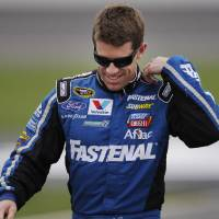 Photo -   Carl Edwards walks to his car during qualifying for Sunday's NASCAR Sprint Cup auto race at Kansas Speedway in Kansas City, Kan., Friday, Oct. 19, 2012. (AP Photo/Orlin Wagner)