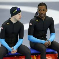 Photo - United States' Patrick Meek, left, and Shani Davis chat during a speedskating training session at the 2014 Winter Olympics in Sochi, Russia, Thursday, Feb. 20, 2014. (AP Photo/Patrick Semansky)