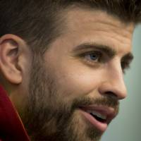 Photo - Barcelona's Gerard Pique answers questions during a press conference at Manchester City's Etihad Stadium, Manchester, England, Monday Feb. 17, 2014. Barcelona will play Manchester City on Tuesday in a Champions League first knock out round soccer match. (AP Photo/Jon Super)