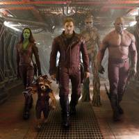 Photo - This image released by Disney - Marvel shows, from left, Zoe Saldana, the character Rocket Racoon, voiced by Bradley Cooper, Chris Pratt, the character Groot, voiced by Vin Diesel and Dave Bautista in a scene from