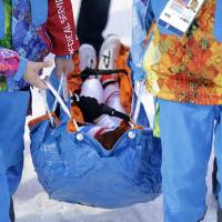 Photo - France's Marie Laure Brunet is carried away after collapsing during her second-kilometer lap, during the women's biathlon 4x6k relay at the 2014 Winter Olympics, Friday, Feb. 21, 2014, in Krasnaya Polyana, Russia. (AP Photo/Lee Jin-man)