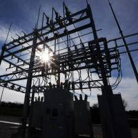 Photo - A silhouetted view of Edmond Electric's C.R. Burgett Substation that is now online, adding 25 megawatts to the city's electric system. A ribbon cutting is being held at 2 p.m. Wednesday. PHOTO BY NATE BILLINGS, THE OKLAHOMAN.  NATE BILLINGS - THE OKLAHOMAN