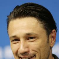 Photo - Head coach of Croatia Niko Kovac smiles during a press conference after a training session at the Arena Pernambuco in Recife, Brazil, Sunday, June 22, 2014. Croatia will play Mexico in group A of the 2014 soccer World Cup. (AP Photo/Petr David Josek)
