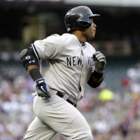 Photo - New York Yankees' Robinson Cano heads to first on a solo home run off Minnesota Twins pitcher Scott Diamond in the first inning of a baseball game, Monday, July 1, 2013, in Minneapolis. (AP Photo/Jim Mone)