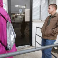 Photo - Nick Henley, far right, from Okla. City, is first in line as he waits for the Okla. Department of Public Safety driver license testing facility to open in downtown Edmond Friday, May 10, 2013.  Nick arrived at 4:45 am to get in line for the door to open at 7 am. Photo by Paul B. Southerland, The Oklahoman