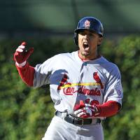 Photo -   St. Louis Cardinals' Jon Jay reacts after doubling in a run against the Chicago Cubs during the tenth inning of a baseball game Saturday, Sept. 22, 2012, in Chicago. (AP Photo/Jim Prisching)